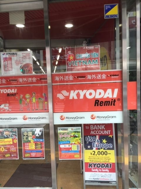 A storefront in Tokyo's Shin-Okubo neighborhood advertising remittance services for foreign residents of Japan